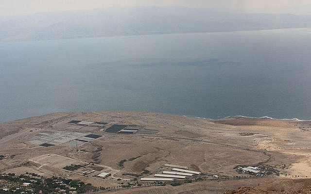 View of the Dead Sea with the Ahava factory near the shore (photo credit: Gilgamesh/Wikimedia Commons)