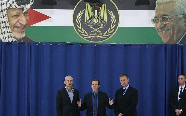 Israeli new Labor Party leader Isaac Herzog speaks during a press conference flanked by his party officials Erel Margalit, right, and Omer Bar-Lev after their meeting with Palestinian President Mahmoud Abbas in the West Bank city of Ramallah, Sunday, Dec. 1, 2013. (photo credit: AP /Majdi Mohammed)