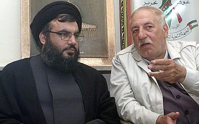 PFLP-GC chief Ahmed Jibril (right) pictured with Hezbollah leader Hassan Nasrallah in Beirut in May 2002. Jibril's son, Jihad Jibril, was killed in a car bombing in Beirut that month. (photo credit: AP Photo/Bassem Tellawi)