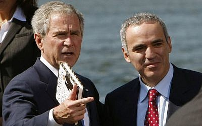 Former US president George W. Bush stands next to Russian dissident Garry Kasparov (photo credit: AP)