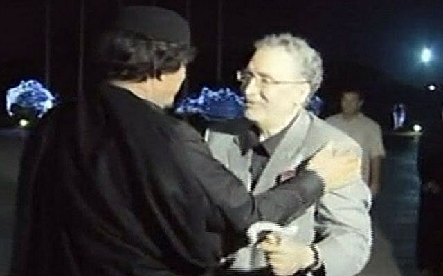 Abdelbaset al-Megrahi, who was found guilty of the 1988 Lockerbie bombing and sentenced to life imprisonment, is greeted by Libyan leader Muammar Gaddafi, in Tripoli, Libya on Friday, Aug. 21, 2009 following his release on compassionate grounds because he had terminal cancer. He died in May 2012 (photo credit: AP Photo/Jamahiriya Broadcasting via APTN)