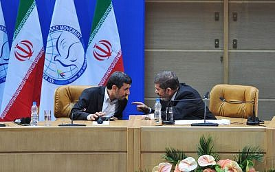 In this photo released by Iranian Students News Agency, ISNA, Iranian President Mahmoud Ahmadinejad, left, speaks to Egyptian President Mohammed Morsi during the summit of the Nonaligned Movement in Tehran, Iran, Thursday, Aug. 30, 2012 (photo credit: AP/Amir Kholousi)