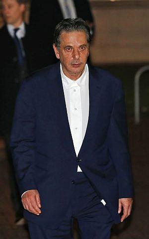 Art dealer Charles Saatchi leaves Isleworth Crown Court in London, Friday, Nov. 29, 2013. (photo credit: AP Photo/Matt Dunham)