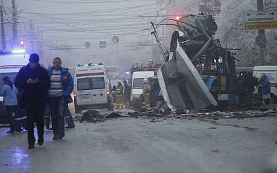 Ambulances line up at the site of a trolleybus explosion, background, in Volgograd, Russia, Monday, December 30, 2013. (AP Photo/Denis Tyrin)