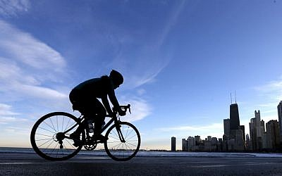 Mayor Rahm Emanuel has made bike lanes and bike programs a signature issue, believing it makes downtown an attractive place for bright young people and innovative companies. (photo credit: AP Photo/Charles Rex Arbogast)