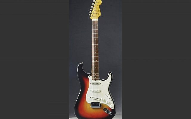This undated photo provided by Christie's Auction House shows the Fender Stratocaster a young Bob Dylan played at the historic 1965 Newport Folk Festival. The festival was a defining moment that marked Dylan's move from acoustic folk to electric rock 'n' roll. The guitar was sold at auction on Friday, Dec. 6, 2013 for $965,000. (photo credit: AP/Christie's Auction House)