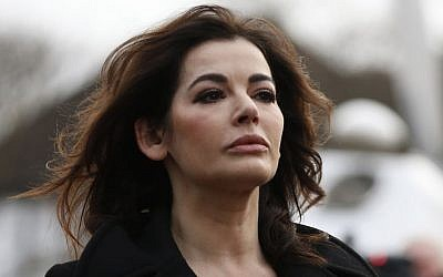 Celebrity chef, Nigella Lawson, arrives at Isleworth Crown Court in London, Thursday, Dec. 5, 2013. (photo credit: AP Photo/Sang Tan)