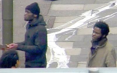 This photo made from CCTV and issued by the Metropolitan Police on Thursday December 19, 2013 shows Michael Adebolajo and Michael Adebowale on May 22, 2013 speaking to a member of the public near the Woolwich Barracks in London. (photo credit: AP/Metropolitan Police)