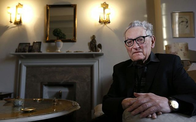 Father Francis Wahle, 84, who was brought to England by Kindertransport from Austria to escape Nazi persecution, sits at his home in London. (photo credit: AP Photo/Kirsty Wigglesworth)