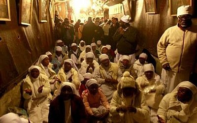 Christian worshipers from Nigeria pray at the Church of Nativity, traditionally believed by Christians to be the birthplace of Jesus Christ, in the West Bank town of Bethlehem on Christmas Eve, Tuesday, Dec. 24, 2013 (photo credit: AP/Majdi Mohammed)