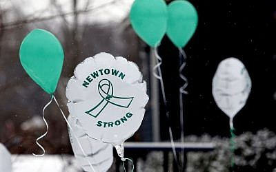 Balloons fly on the first anniversary of the Sandy Hook massacre, in Newtown, Connecticut, on Saturday, December 14, 2013. (photo credit: AP/Robert F. Bukaty)