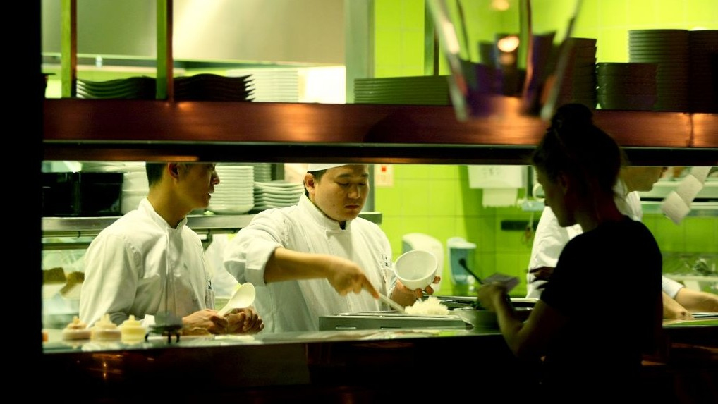 Chinese foreign workers cook in a Tel Aviv restaurant, 2008. (photo credit: Moshe Shai/Flash90)
