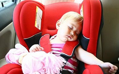 Illustrative photo of a baby sleeping in a car seat (photo credit: Chen Leopold/Flash90)