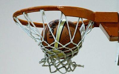A basketball falls through the hoop,  December 18 2007. (photo credit: Moshe Shai/Flash90)