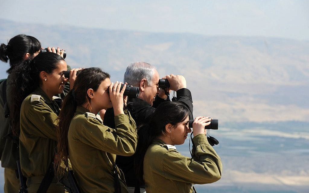Prime Minister Netanyahu, who has demanded a permanent Israeli presence in the Jordan Valley, with IDF officers in the region in 2011 (photo credit: Moshe Milner/GPO/ Flash90)