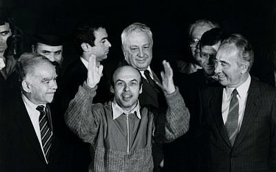Former Soviet Prisoner of Zion Natan Sharansky with prime minister Shimon Peres, foreign minister Yitzhak Shamir, and Ariel Sharon, after his release from prison in the Soviet Union, on arrival in Israel on February 11, 1986. (Photo credit: Moshe Shai/FLASH90)