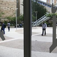 The symbol of The Hebrew University on the doorways of the buildings of the university's Hadassah Ein Kerem medical center campus, June 16, 2013. (photo credit: Flash90)