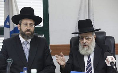 Chief Sephardic Rabbi Yitzhak Yosef (R) and Chief Ashkenazi Rabbi David Lau, in Jerusalem on August 28, 2013. (photo credit: Yonatan Sindel/Flash90)