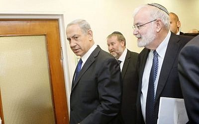 Prime Minister Benjamin Netanyahu with his former National Security Adviser Ya'akov Amidror and (background) cabinet secretary Avichai Mandelblit at the PMO in Jerusalem on November 3, 2013. (Photo credit: Miriam Alster/FLASH90)