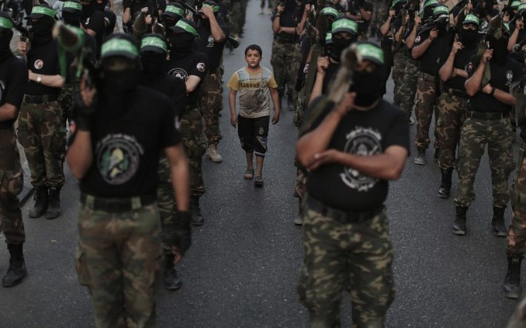 Members of the Izz ad-Din al-Qassam Brigades, Hamas's armed wing, stage an anti-Israel parade as part of the celebrations marking the first anniversary of Operation Pillar of Defense, on November 14, 2013. (Photo credit: Wissam Nassar/Flash90)