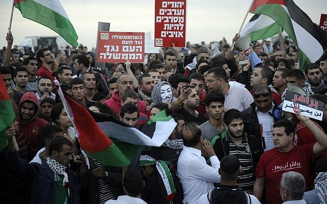 Police and protesters clash at a rally where around 1,200 demonstrators gathered in the southern Israeli town of Hura during a protest against the government's plan to resettle some 30,000 Bedouin residents of the Negev desert Saturday. (photo credit: David Buimovitch/Flash90)