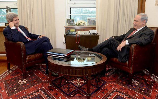 Prime Minister Benjamin Netanyahu speaks with US Secretary of State John Kerry in Jerusalem, Thursday, December 5, 2013 (photo credit: Kobi Gideon/GPO/Flash90)