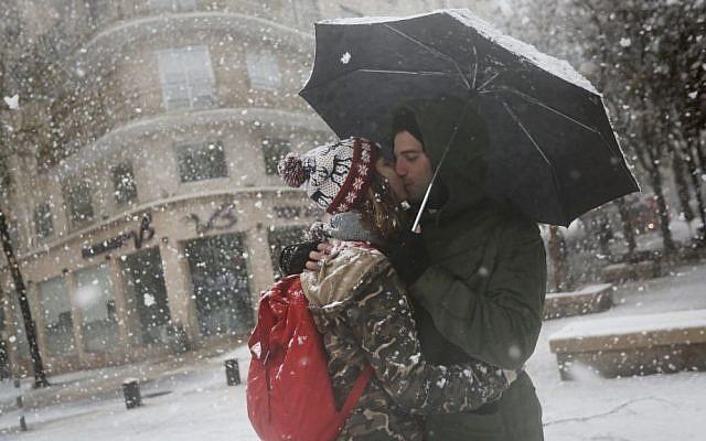 Jerusalemites enjoy the snow in the capitals Ben-Yehuda Street, Thursday, December 12, 2013 (photo credit: Miriam Alster/Flash90)