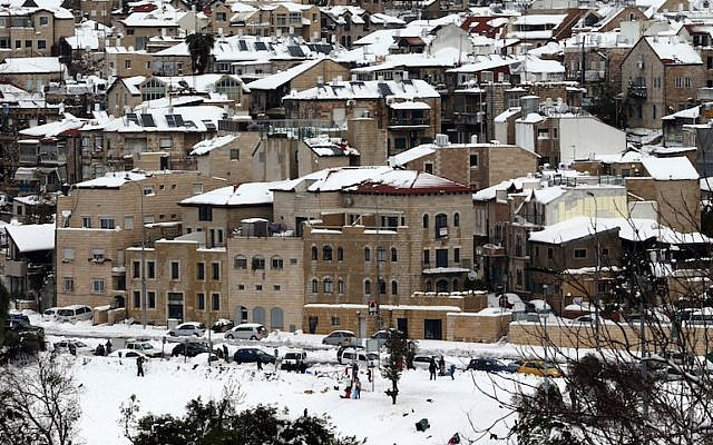 The snow-covered rooftops of Jerusalem's Nachlaot neighborhood (photo credit: Nati Shohat/Flash90)