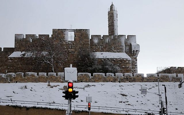 A view of the the snow-covered walls of Jerusalem's Old City, Saturday, December 14, 2013 (photo credit: Nati Shohat/Flash90)