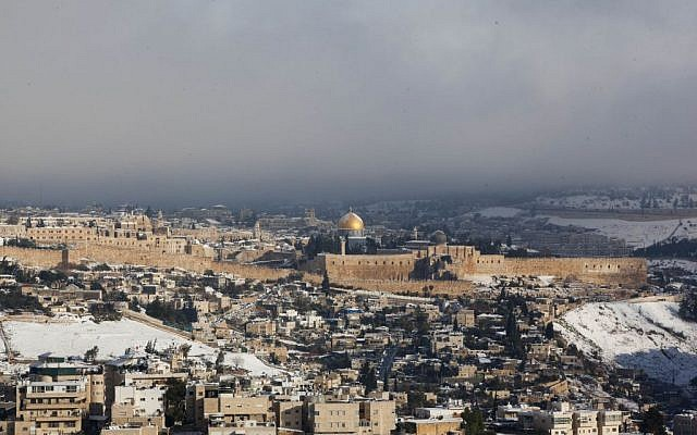View of the snow-covered Dome of the Rock in Jerusalem's Old City, as seen from the Armon Hanatziv promenade, Saturday, December 14, 2013. (photo credit: Yonatan Sindel/Flash90)