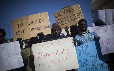 """Sudanese refugees demonstrate in front of the Knesset in protest of the new """"Holot"""" detention camp for illegal migrants, on Monday, December 17, 2013. (photo credit: Yonatan Sindel/Flash90)"""