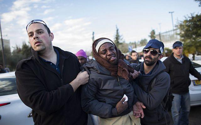 Immigration officials arrest Sudanese migrants in front of the Knesset building in Jerusalem, Monday, December 17, 2013. (photo credit: Yonatan Sindel/Flash90