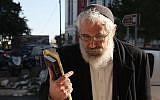 Rabbi Mordechai Elon arrives at the Jerusalem Magistrate's Court to hear his sentence, December 18, 2013. (photo credit: Meital Cohen/Flash90)