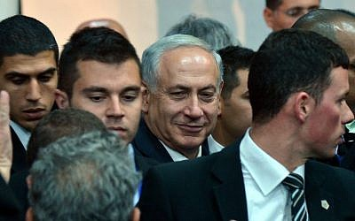 Prime Minister Benjamin Netanyahu arrives at a Likud party conference in Tel Aviv in December 2013 (photo credit: Yossi Zeliger/Flash90)