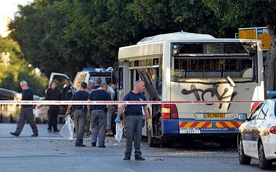 Police and rescue personnel at the scene of an explosion on a Bat Yam passenger bus on Sunday, December 22, 2013. (photo credit: Yossi Zeliger/Flash90)