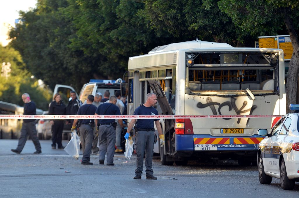 Israeli police and rescue personnel at the scene of an explosion on a bus in Bat Yam, Sunday December 22, 2013 (photo credit: Yossi Zeliger/Flash90)