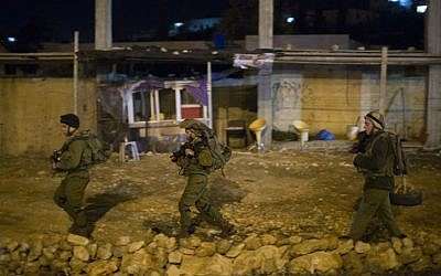 IDF soldiers on patrol near where a police officer was stabbed Monday (photo credit: Yonatan Sindel/ lash90)