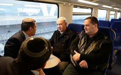 Prime Minister Benjamin Netanyahu (center) with Transportation Minister Yisrael Katz (right) inaugurating Sderot's train station in December 2013. (photo credit: Kobi Gideon /GPO/FLASH90)