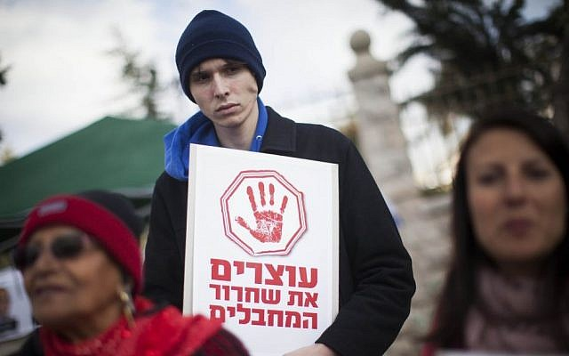 """Bereaved families demonstrate with signs saying """"stop the release of terrorists,"""" in front of the Prime Minister's residence in Jerusalem on Wednesday, December 25, 2013. (Photo credit: Yonatan Sindel/Flash 90)"""