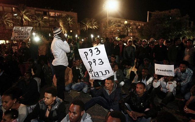 African asylum seekers participate in a protest march in Tel Aviv, Israel, Saturday, December 28, 2013 (photo credit: Roni Schutzer/Flash90)