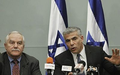 Finance Minister Yair Lapid (R) and Minister of Agriculture Yair Shamir attend a press conference announcing a controlled reduction of the price of soft white cheese and whipping cream, December 30, 2013. (photo credit: Miriam Alster/Flash90)
