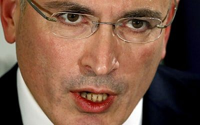 Mikhail Khodorkovsky speaks during a news conference in Berlin, Sunday, Dec. 22, 2013.  (photo credit: AP Photo/Michael Sohn)