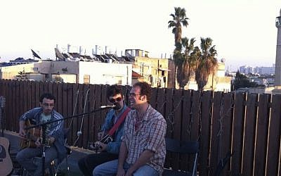 Performing at the Friday on the rooftop series at Ami Yares's Jaffa apartment. From right: Ami Yares, Avi Salloway, and Jason Reich (photo credit: Michal Shmulovich)