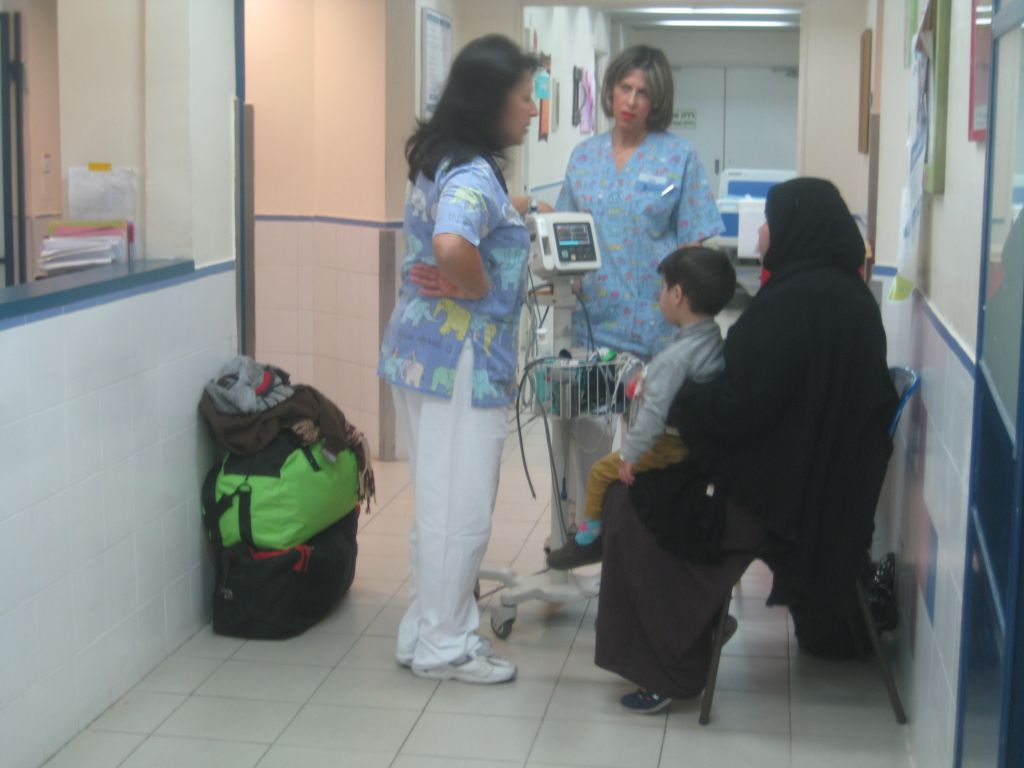 Four-year-old Maath receives initial inspections from nurses at Holon's Wolfson Medical Center. (photo credit: Ilan Ben Zion/Times of Israel staff)