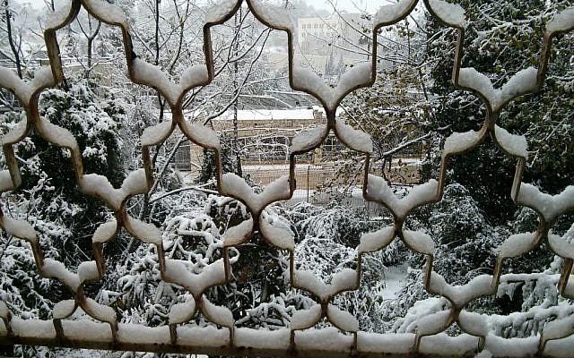 Snow outside a Jerusalem window, Thursday, December 12, 2013 (photo credit: Haviv Rettig Gur/Times of Israel)