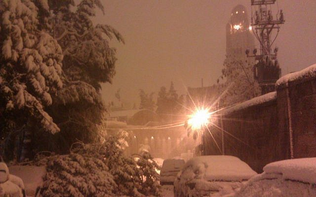 Snow in Jerusalem just after midnight Friday. (photo credit: Ilan Ben Zion / Times of Israel)