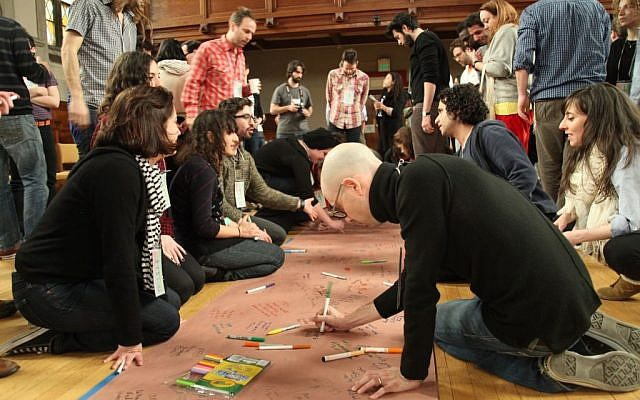 At the March Asylum Arts workshop, participants create a community timeline.  (photo credit: Shulamit Siedler-Feller)