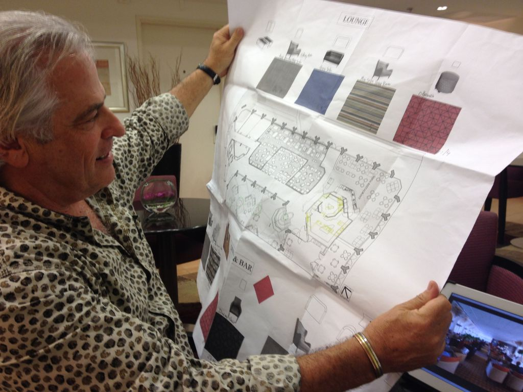 Michael Schwartz shows the hotel's renovation plans, which includes redoing the inner lobby with more intimate seating and work areas (photo credit: Jessica Steinberg/Times of Israel)