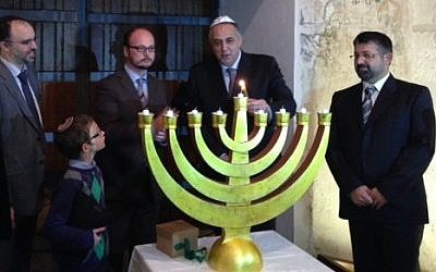 Hanukkah lighting ceremony at the infamous Steri Prison in Palermo, Sicily, the former seat of the local Inquisition.  (photo credit: courtesy/ Shavei Israel)
