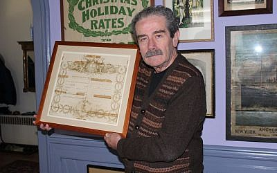 Major League Baseball's official historian, John Thorn, pictured holding a royal decree knighting his great-grandfather, says the past enhances the present in sports as well as family matters. (photo credit: Hillel Kuttler/JTA)